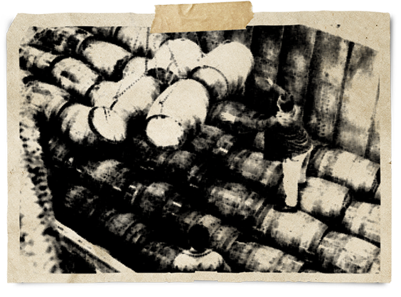 Photo of old barrels on ship.=